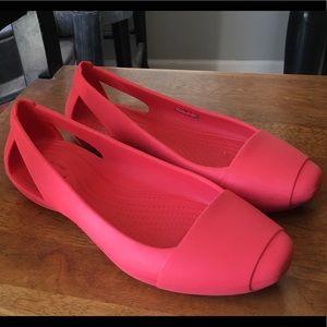 Crocs size 7 reddish pink slip on shoes